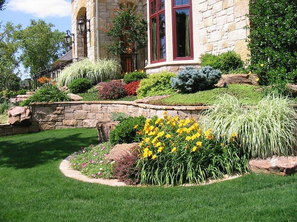 Scotts Lawn Service for a  Landscape with a Retainer Walls and Our Work by Sami's Landscape & Tree Service