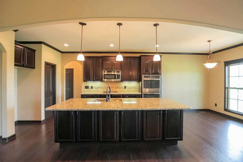 Sears Clarksville Tn for a Contemporary Kitchen with a Double Sink and Brick and Stone Two Story with Neighborhood Amenities by Crabbe Homes