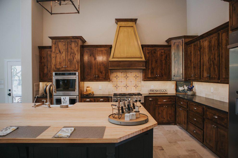 Sears San Angelo for a Farmhouse Kitchen with a Limestone Backsplash and San Angelo Farmhouse by Le Belle Maison Interiors Inc.