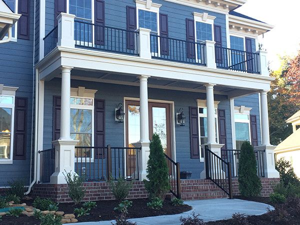 Seegars Fence for a  Exterior with a Blue Shutters and Our Fences by Seegars Fence Company