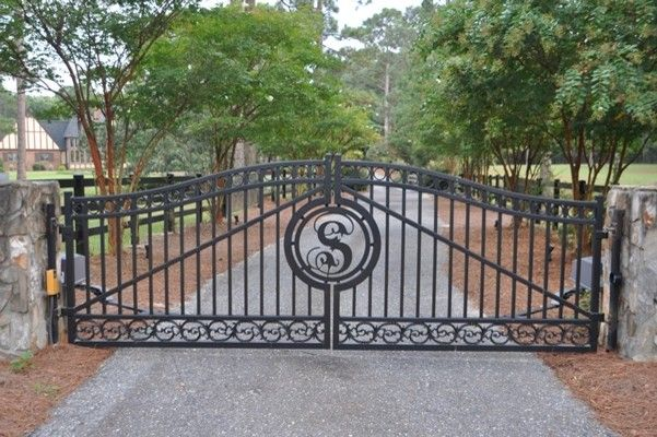 Seegars Fence for a  Exterior with a Ornamental Gate and Our Fences by Seegars Fence Company