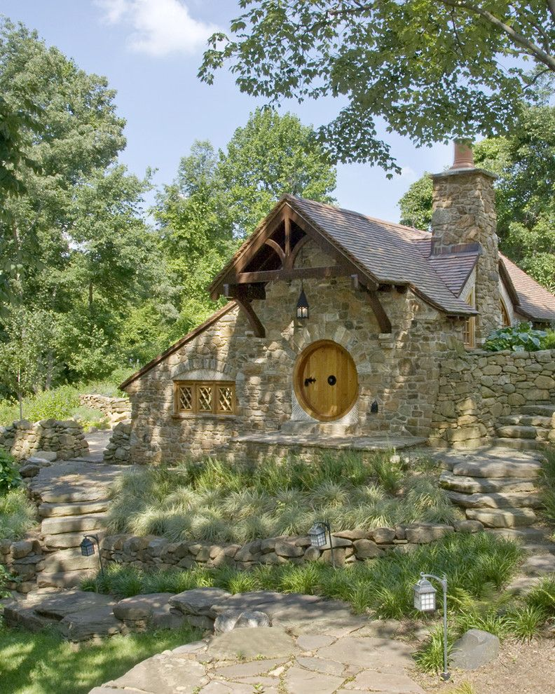 Shingles in Spanish for a Rustic Exterior with a Chimney and Hobbit House   Front View by Archer & Buchanan Architecture, Ltd.