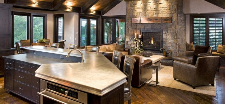 Shipping Crate Homes for a Rustic Family Room with a Exposed Beams and Rustic Family Room by John Kraemer & Sons