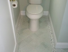 Shoshana for a Transitional Powder Room with a Mosaic Border and Bathrooms by Shoshana Halpert Designs