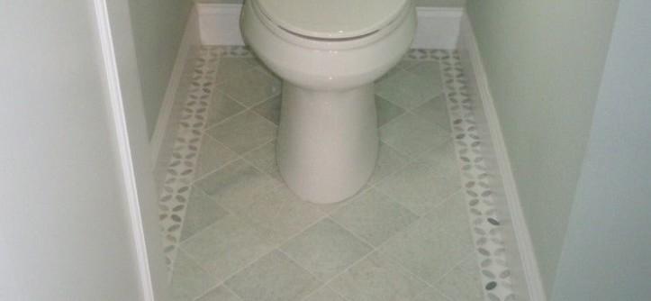 Shoshana for a Transitional Powder Room with a Mosaic Border and Bathrooms by Shoshana Halpert Designs