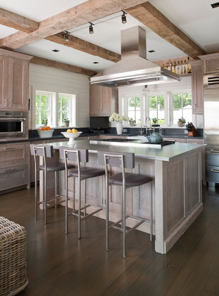 Siesta4rent for a Beach Style Kitchen with a Kitchen Island and Darien Beach House by Shelter Interiors Llc