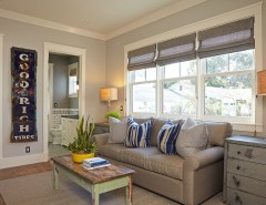 Sighn for a Transitional Family Room with a Small Coffee Table and Wildlife by Brooke Wagner Design