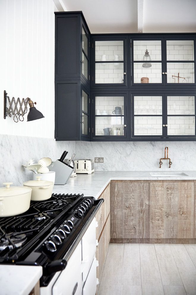 Sightline for a Scandinavian Kitchen with a Glazed Cabinets and Industrial Chic by Blakes London