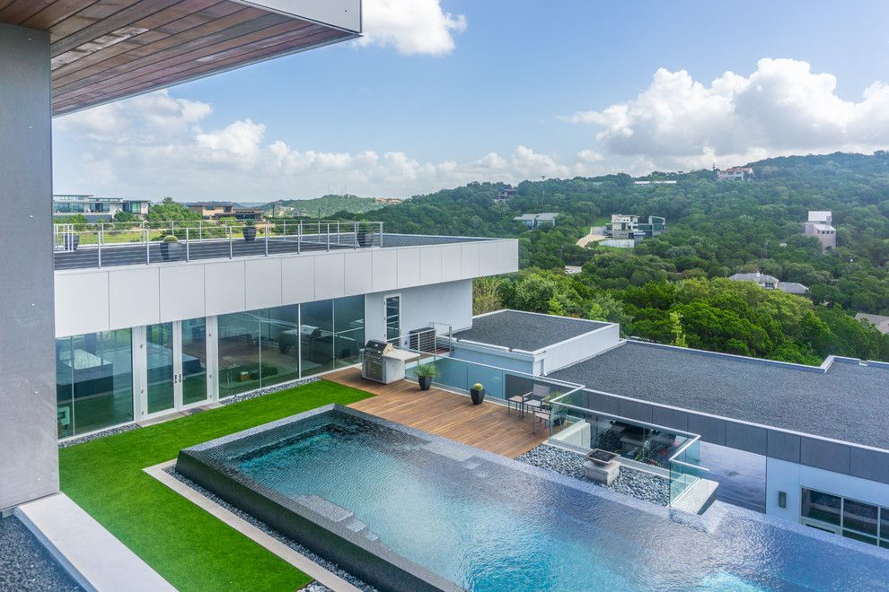 Simply Austin Furniture for a Modern Pool with a Luxury Backyard and West Lake Hills Infinity Edge Pool & Decks (Ipe, Cable Railing) by Timbertown