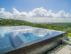 Simply Austin Furniture for a Modern Pool with a Modern Pool and West Lake Hills Infinity Edge Pool & Decks (Ipe, Cable Railing) by TimberTown
