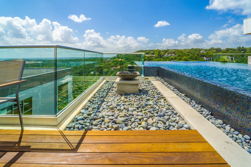 Simply Austin Furniture for a Modern Pool with a Pool with a View and West Lake Hills Infinity Edge Pool & Decks (Ipe, Cable Railing) by Timbertown