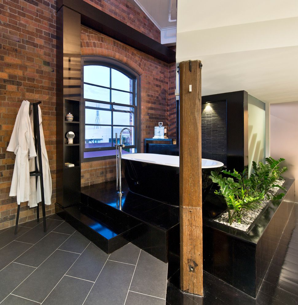 Sioux City Brick for a Industrial Bathroom with a Floor Mount Faucet and the Carson Woolstore by Tonic Design