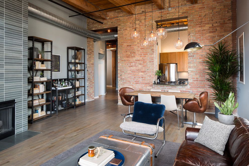 Sioux City Brick for a Industrial Living Room with a High Ceilings and River North Loft by Haven Design Studio