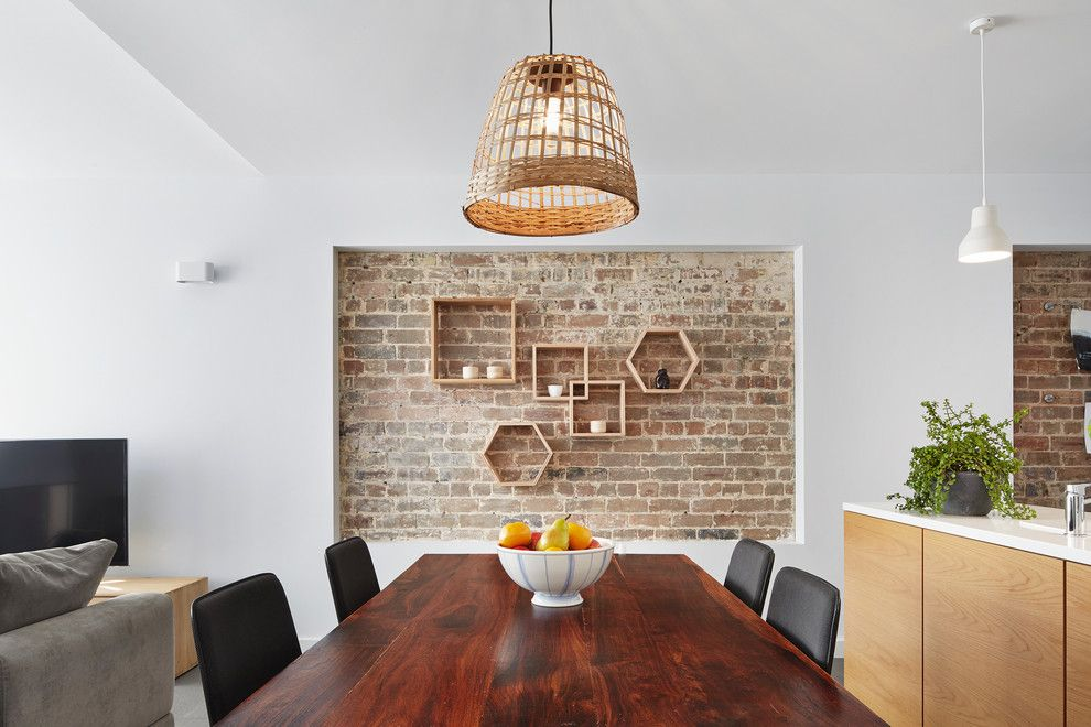 Skim Coat Walls for a Contemporary Dining Room with a White Countertop and Urban House by Elaine Richardson Architect