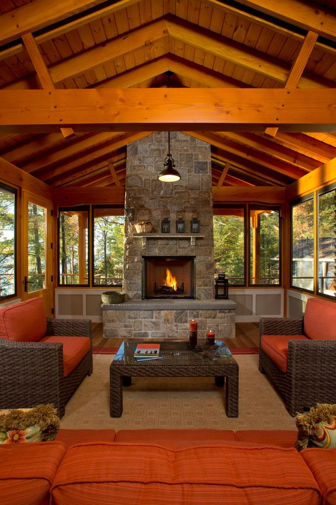 Skim Coating for a Rustic Porch with a Raised Hearth Fireplace and Bolton Landing Modern Cabin by Teakwood Builders, Inc.