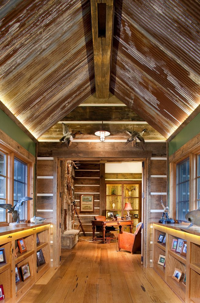 Skunk Smell in House for a Rustic Hall with a Caged Pendant Light and Mine Style Rustic Mountain Lodge by Copper Creek Homes, Llc