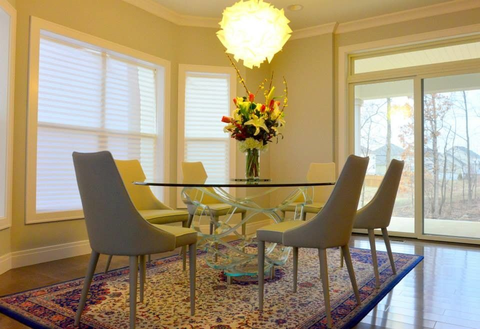 Slamp for a Contemporary Dining Room with a Round Dining Table and Luxe House in Urbana Champaign, Il by Iqmatics