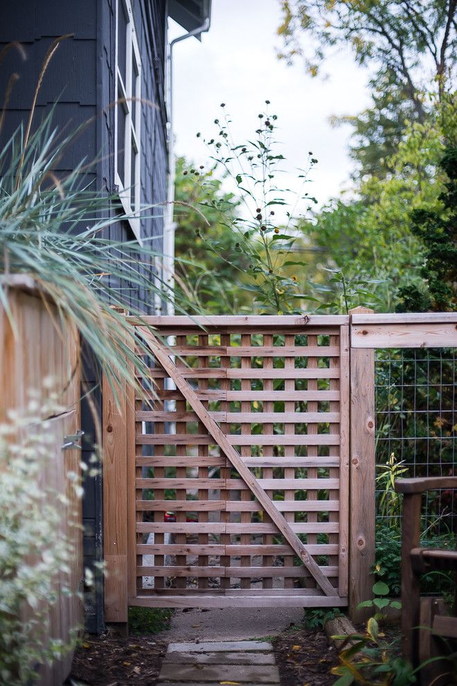 Sloat Garden Center for a Traditional Landscape with a Wood Fence and Cozy Backyard Family Space by Lotus Gardenscapes & Bloom Garden Center