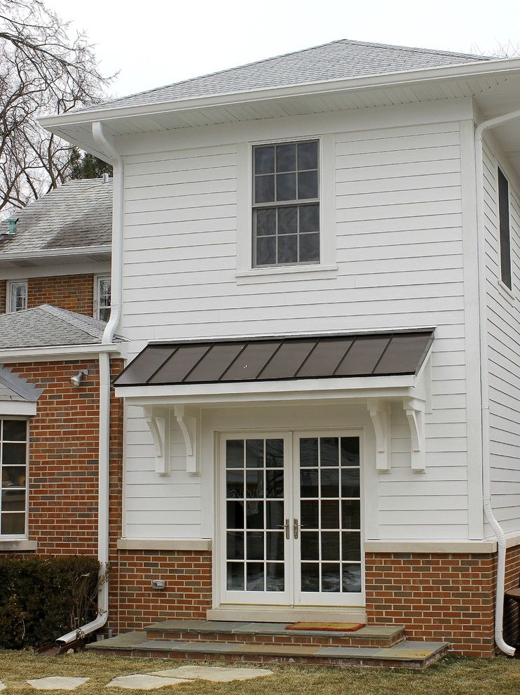 Smalls Chicago for a Traditional Exterior with a White Siding and Exterior Addition by Great Rooms Designers & Builders