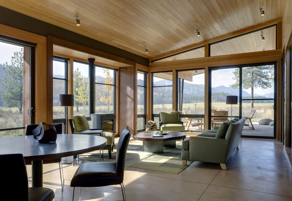 Southern Crushed Concrete for a Modern Living Room with a Knotty Pine and Wolf Creek by Prentiss Balance Wickline Architects
