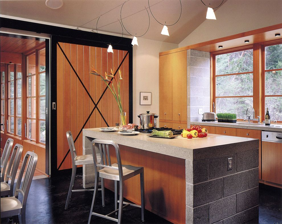 Southern Crushed Concrete for a Rustic Kitchen with a Concrete Island and Buchter Retreat by David Coleman / Architecture