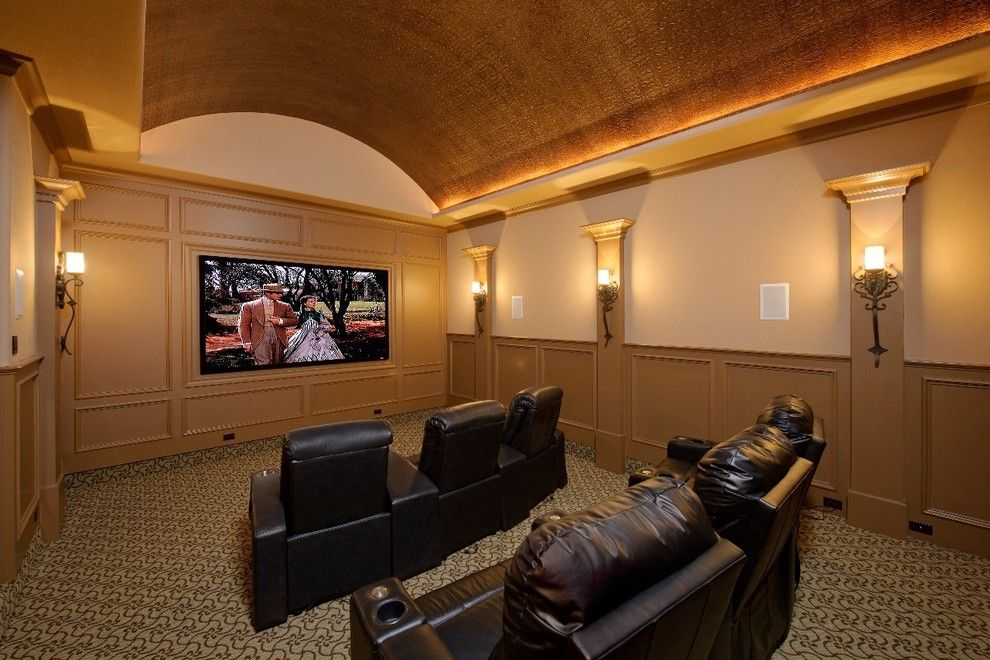 Southlake Movie Theater for a Mediterranean Home Theater with a Black Leather Armchairs and Wood Forest by Gary Keith Jackson Design Inc