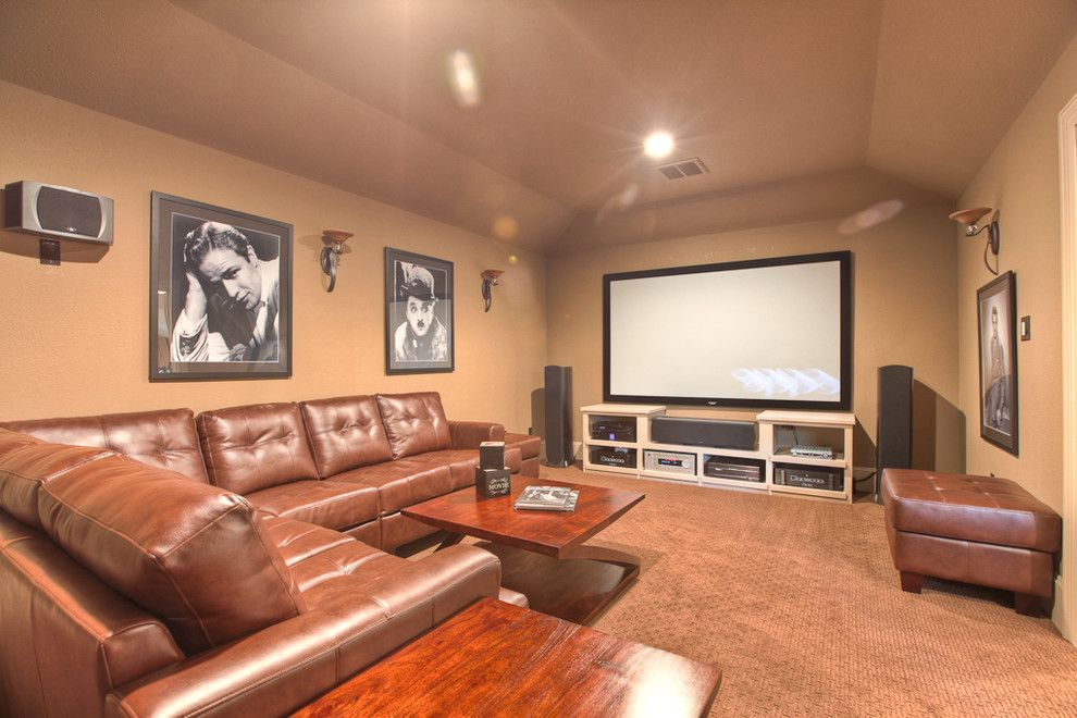 Southlake Movie Theater for a Traditional Home Theater with a Wall Sconce and Traditional Media Room by Silvanhomes.com