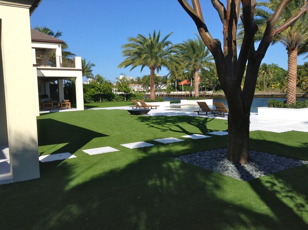Southwest Greens for a Traditional Landscape with a Stone Pavers and Artificial Grass by Southwest Greens of Florida