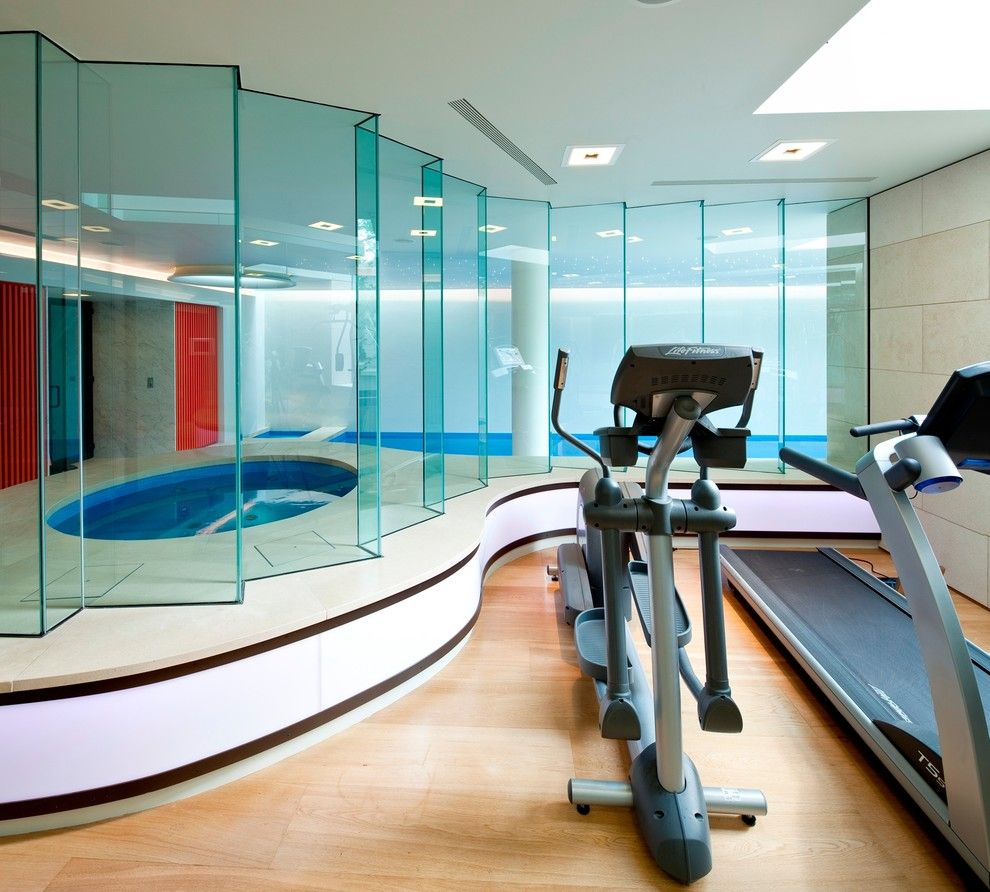 Spca New Orleans for a Modern Home Gym with a Safety Glass and Basement Pool in London by Design by Guncast