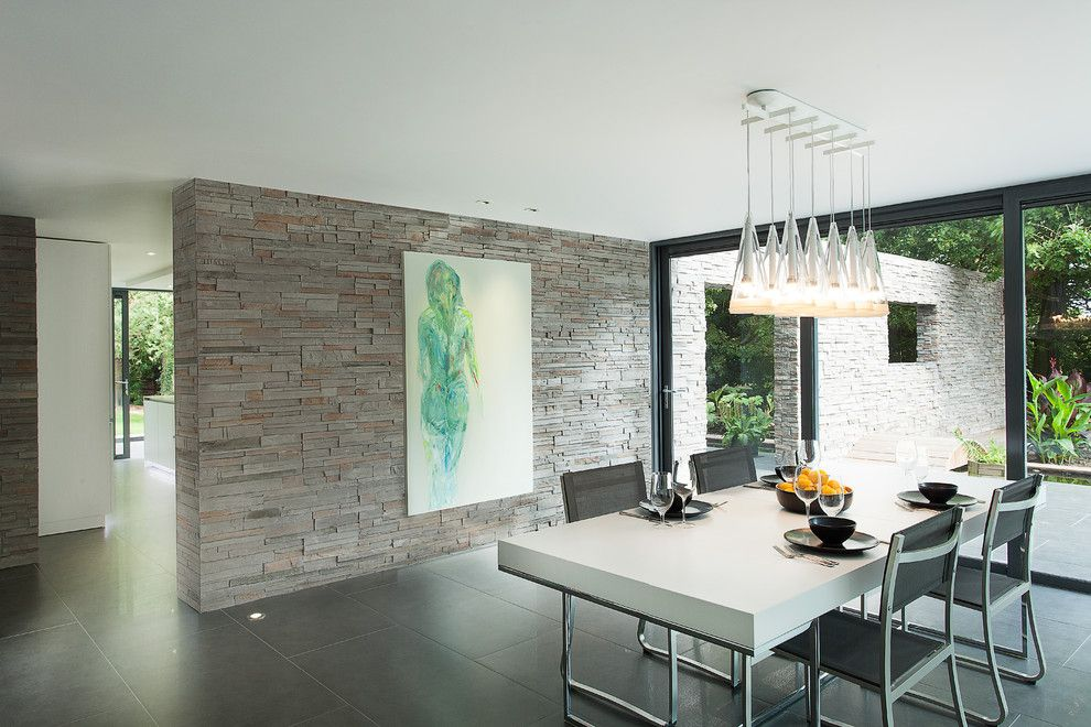 Spectra Contract Flooring for a Modern Dining Room with a Pendant Chandelier and Abbots Way by Ar Design Studio Ltd