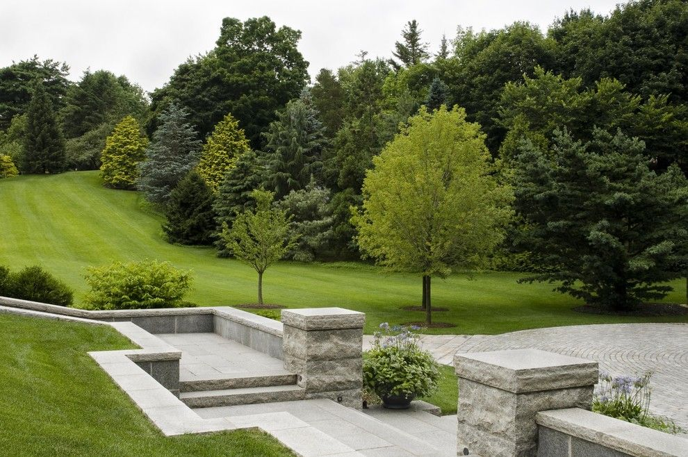 Spring Cleaning Checklist for a Traditional Landscape with a Sloping Garden and Classic Home and Landscape by R. P. Marzilli & Company Landscape Contractor