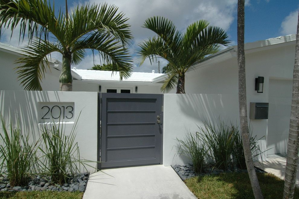 Spring Cleaning Checklist for a Tropical Entry with a White Exterior and Modern Renovation by Schachne Architects & Builders