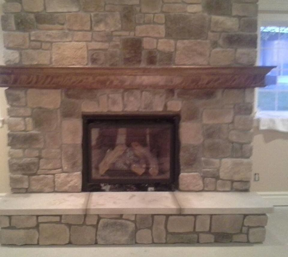 St Albans Mo for a Traditional Spaces with a Fireplaces in Chesterfield Missouri and Indoor Fireplace Built From Faux Stone in Chesterfield, Mo by Masterpiece Masonry