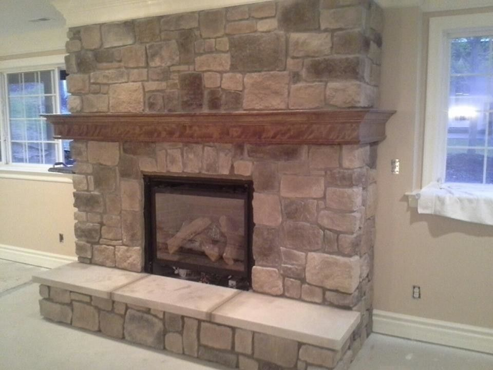 St Albans Mo for a Traditional Spaces with a Fireplaces in St Louis Missouri and Indoor Fireplace Built From Faux Stone in Chesterfield, Mo by Masterpiece Masonry