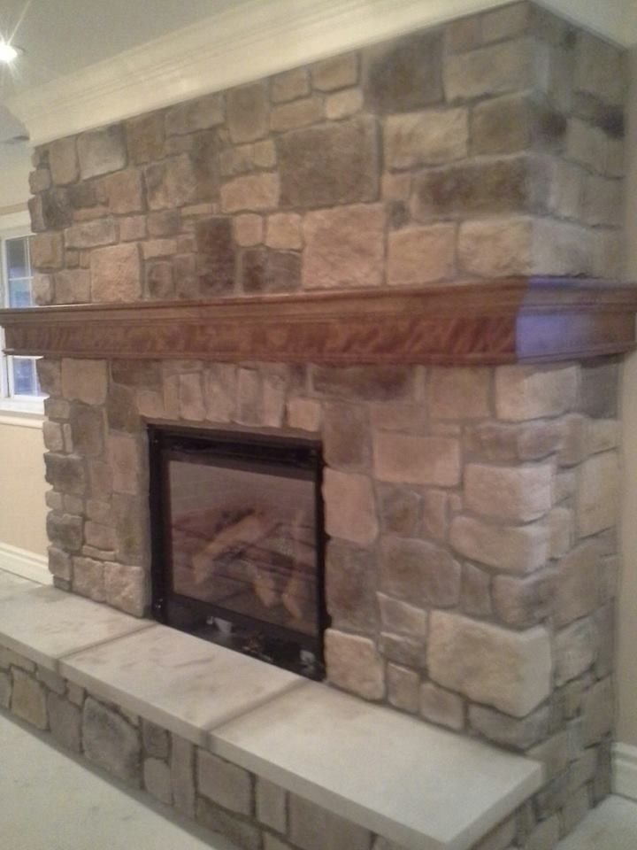 St Albans Mo for a Traditional Spaces with a Indoor Fireplaces Chesterfield Mo and Indoor Fireplace Built From Faux Stone in Chesterfield, Mo by Masterpiece Masonry