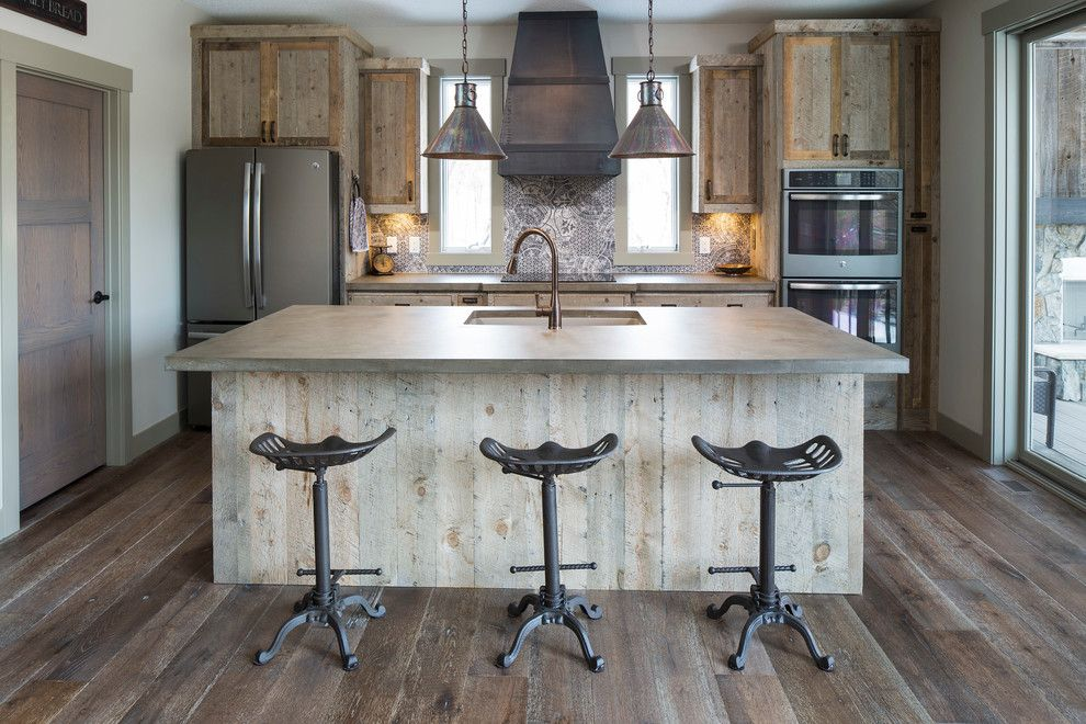 St Croix Theater for a Rustic Kitchen with a Barn Wood Cabinetry and St Croix Trail by Hartman Homes