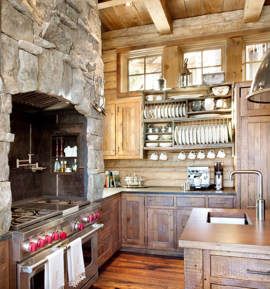 Stainless Steel vs Nonstick for a Rustic Kitchen with a Stone Range Hood and Kitchen by Peace Design