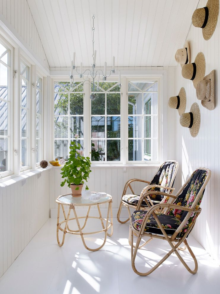 Stash Furniture for a Farmhouse Sunroom with a Altnambler and Totalrenovering Och Inredning Av 1800 Talsgård by Chrispdesign