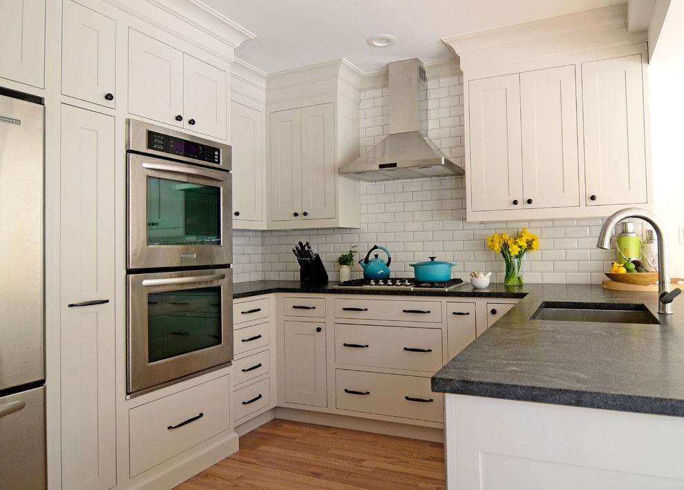 Stiles Construction for a Traditional Kitchen with a Grey Cabinets and Rockwood Colonial Larchmont by Studio Dearborn