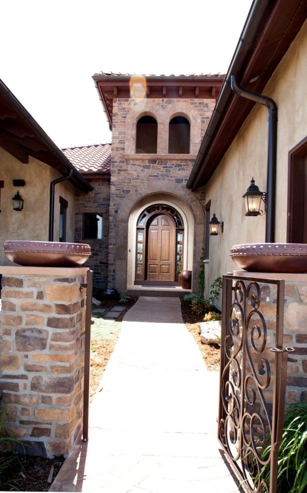 Sto Stucco for a Mediterranean Entry with a Wall Lighting and Exterior Entry by Aneka Interiors Inc.