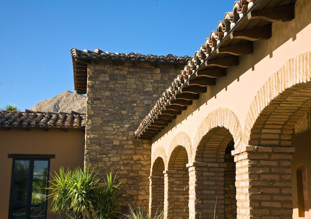 Sto Stucco for a Mediterranean Exterior with a Yellow and Rancho Mirage Villas by Sennikoff Architects, Inc.