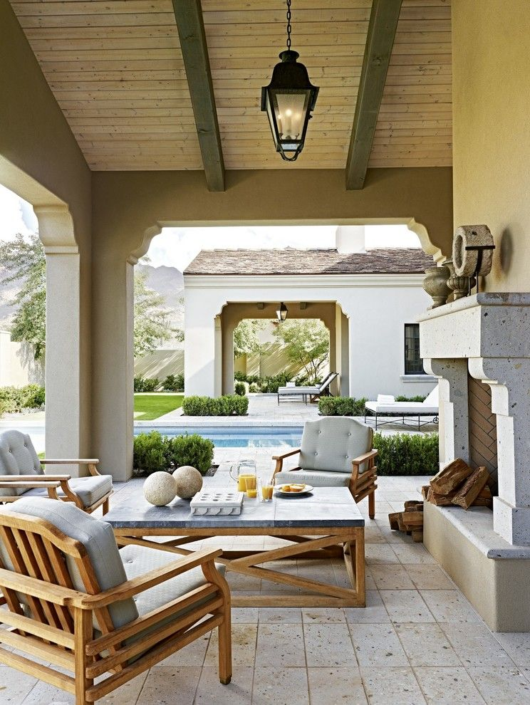 Sto Stucco for a Traditional Patio with a Stone Fireplace Mantel and Eclectic Desert Pied 'A Terre by David Michael Miller Associates