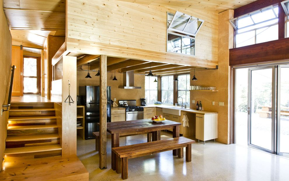 Straw Bale Construction for a Rustic Kitchen with a Arkin Tilt Architects and Chalk Hill Off Grid Cabin Kitchen by Arkin Tilt Architects