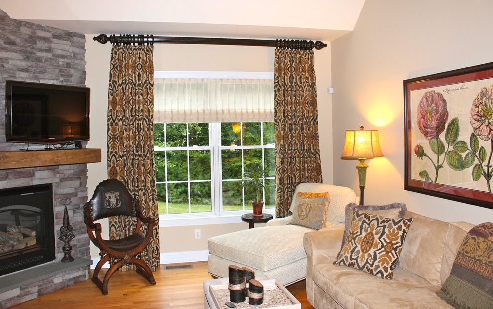 Stroheim for a Traditional Living Room with a Black Drapery Hardware with Gold and Drapery by Mitchell Designs Llc