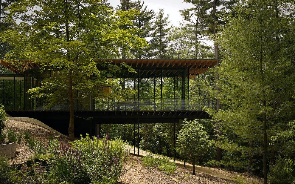 Sudio for a Modern Exterior with a Slope and Wood and Glass House by Keuka Studios, Inc
