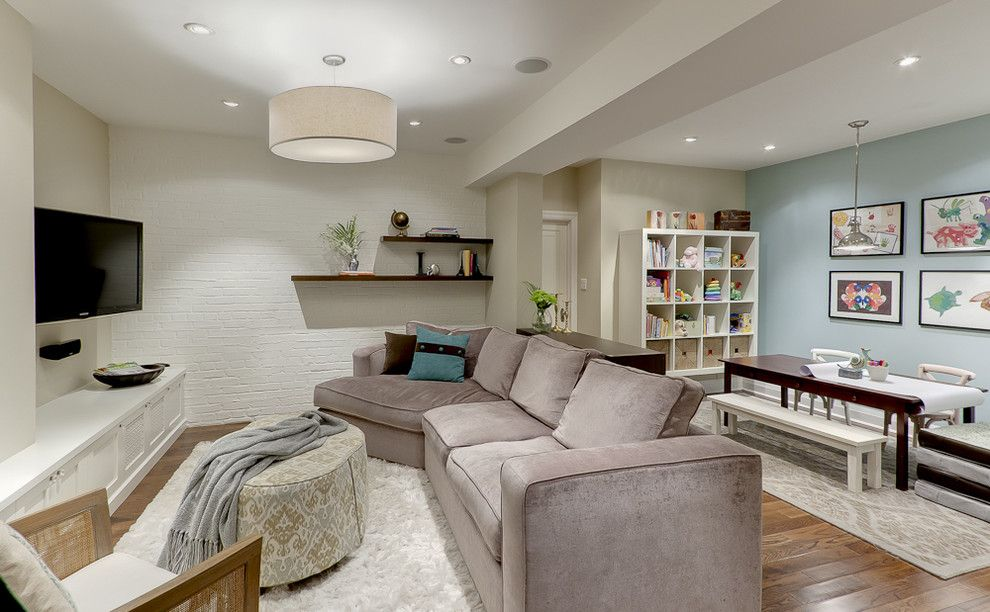 Sudio for a Traditional Basement with a Great Room and Basement Family Room by Leslie Goodwin Photography