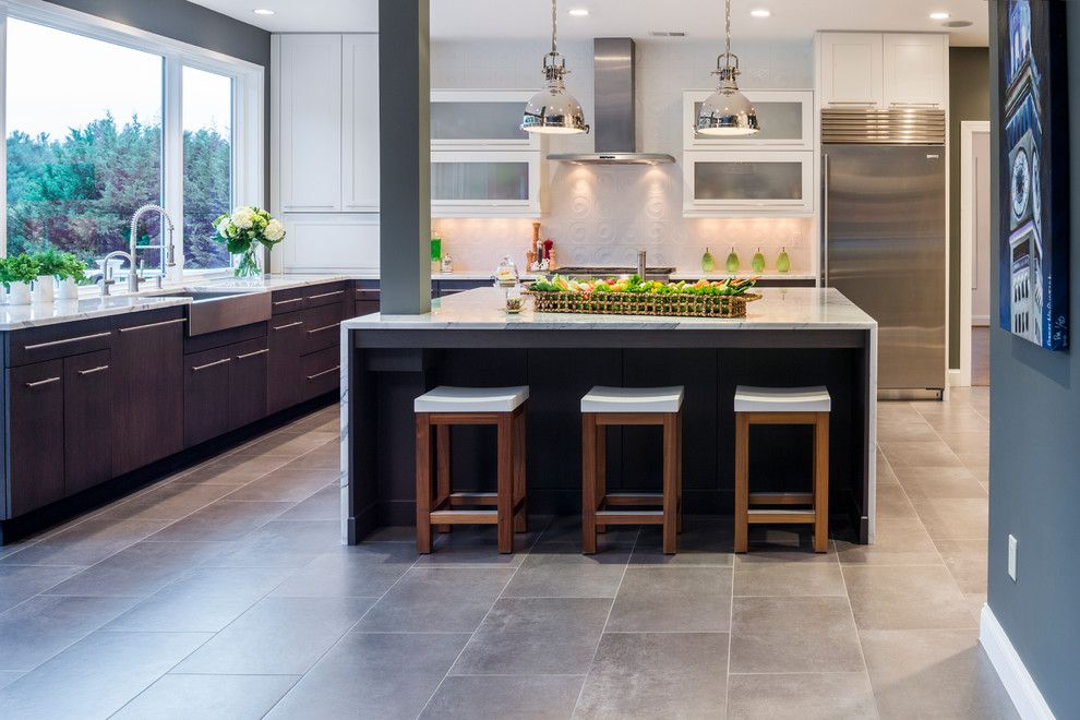Summit Appliance for a Contemporary Kitchen with a Waterfall Edge Countertops and the Ultimate Kitchen! by Beth Cohen Raymond Interior Design