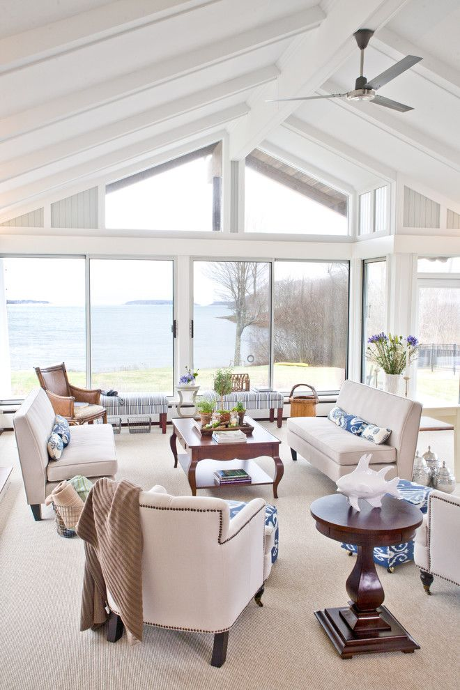 Sun Realty Outer Banks for a Traditional Family Room with a Sofa and Coastal Maine Home by Celia Bedilia