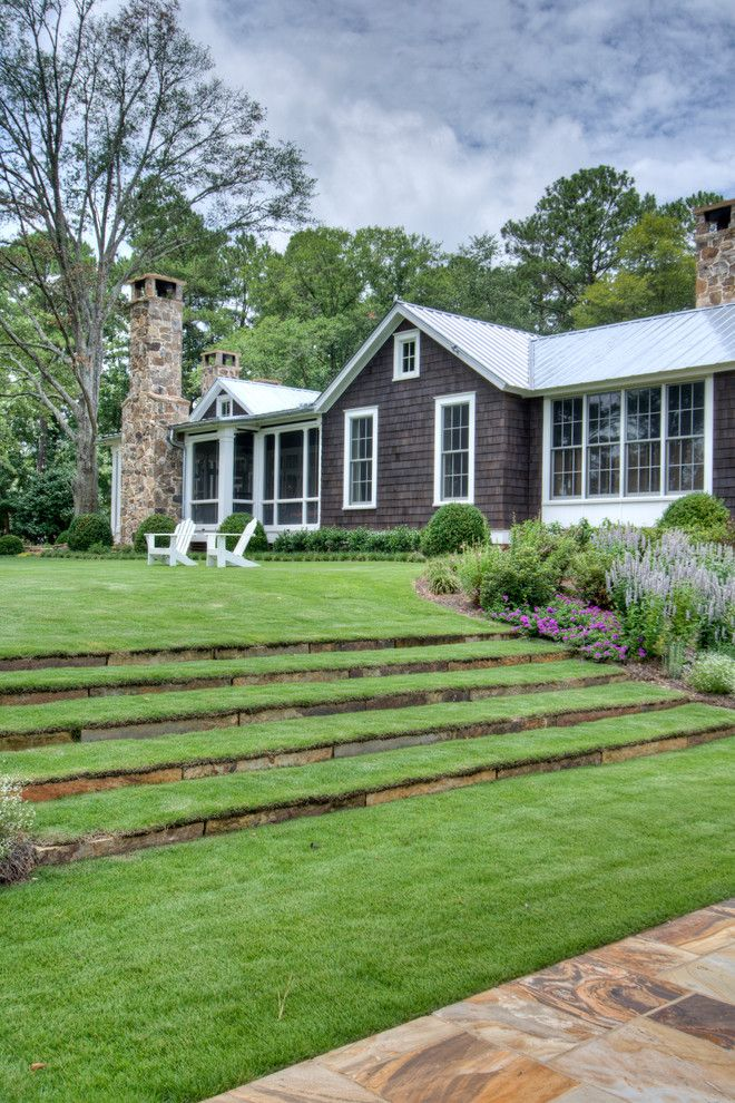 Suncoast Property Management for a Farmhouse Landscape with a Hillside Landscaping and From Pre Fab to Farmhouse by Historical Concepts