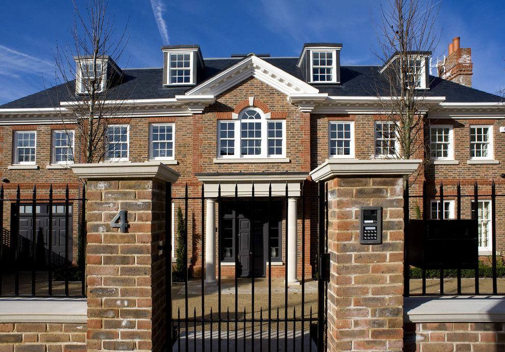 Suncoast Property Management for a Transitional Exterior with a Gate Control and Roehampton Development by Inspired Dwellings